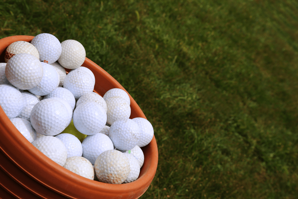 Golf Balls. A full bucket of golfballs